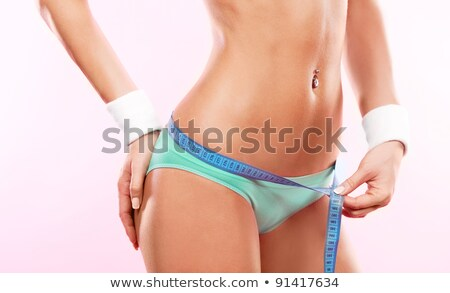 Curvy woman measuring her waist Stock photo © stryjek