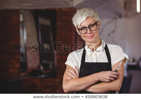 Donfident female hairdresser with hair scissors Stock photo © wavebreak_media