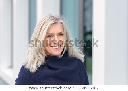 Pretty aged woman in stylish overcoat Stock photo © stockyimages