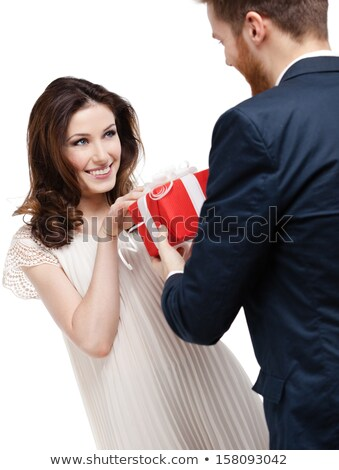 man wondering about what is in his present box Stock photo © feedough