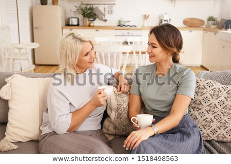 portrait of lovely young woman having cup of tea at home stock photo © dashapetrenko