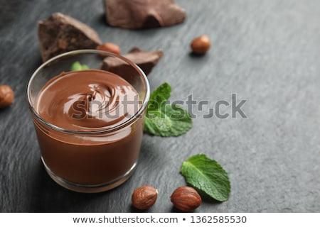 Csokoládé puding desszert edény tele cseresznye Stock fotó © songbird