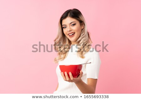 Young Woman Eating Bowl Of Healthy Breakfast Cereal In Studio Stock photo © monkey_business