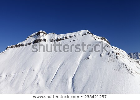Snowy rocks with traces from avalanche Stock photo © BSANI
