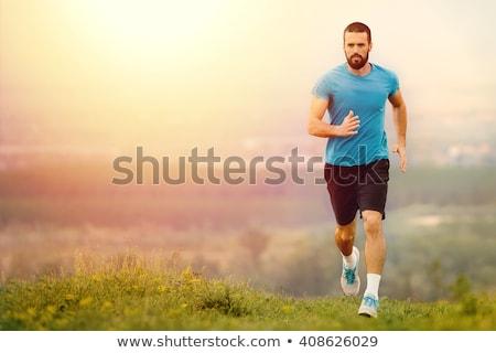 Junger Mann läuft Freien Morgen Sport Natur Stock foto © luckyraccoon