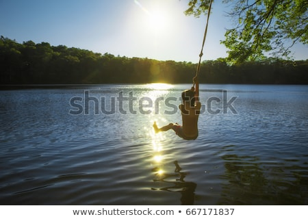 the boy in the water of lake stock photo © efischen