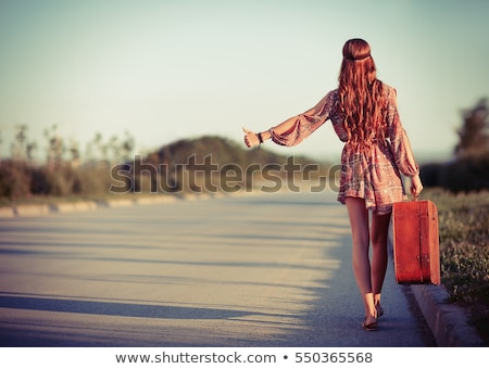 Hitchhiking woman Stock photo © gemenacom