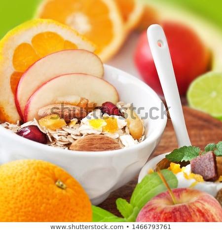 dried figs, oatmeal and orange juice breakfast setting Stock photo © martince2