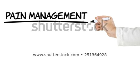 Hand with pen writing Pain Management Stock photo © Zerbor