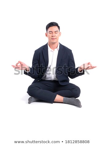 peaceful asian caucasian businessman in office stock photo © hasloo