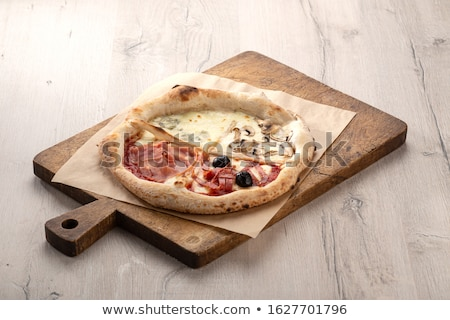 Pepper tomato and cheese on the kitchen board Stock photo © pixelman