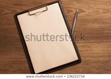 blank white paper on clipboard and notebook with cup of coffee stock photo © happydancing