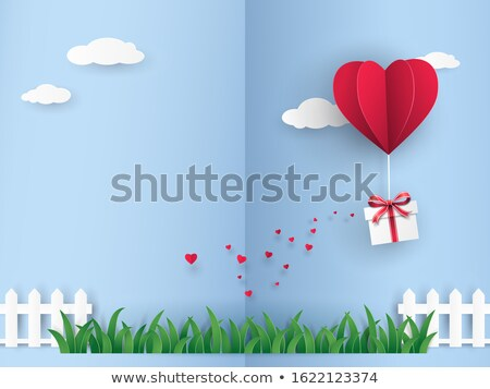 balloons fly out of gift box on green grass stock photo © tatik22