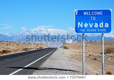 Karşılama Nevada yol işareti imzalamak seyahat karayolu Stok fotoğraf © AndreyKr