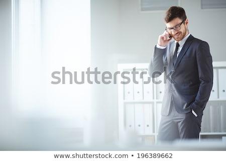 ernstig · bebaarde · zakenman · pak · naar · mobiele · telefoon - stockfoto © fuzzbones0