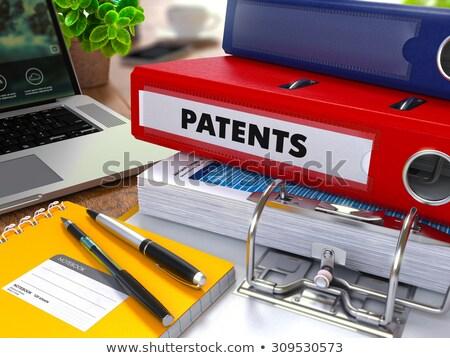 red ring binder with inscription patents stock photo © tashatuvango