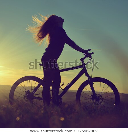 Fiatal nő hegyi kerékpár nyújtott mező tavasz portré Stock fotó © nenetus