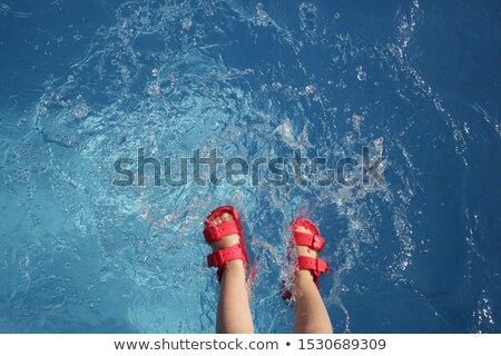 Baby sandals at the edge of swimming pool Stock photo © filipw