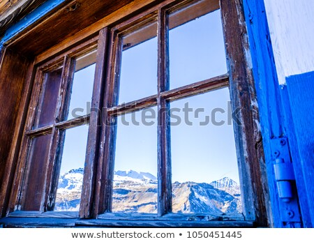 nice window with open brown wooden shutters and curtains stock photo © vlaru