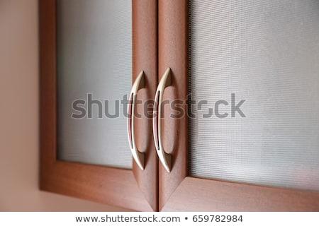 Fából készült faliszekrény fiókok fém fogantyú közelkép Stock fotó © stevanovicigor