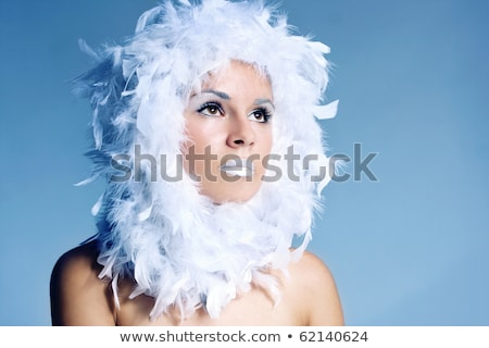 fine art portrait of a beautiful lady in fur stock photo © konradbak