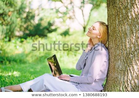 Nő dől fa kint nevet fű Stock fotó © deandrobot