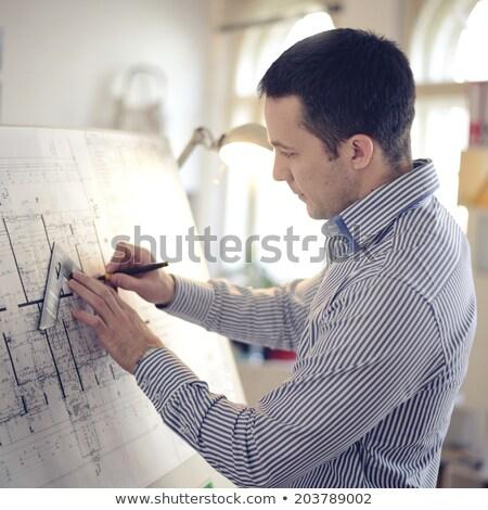 Architect working on blueprint,chart indoors Stock photo © deandrobot