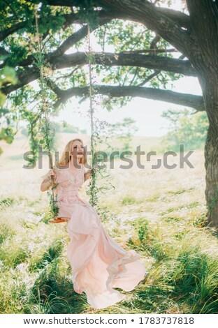 fine art photo of a young beauty sitting on grass stock photo © konradbak