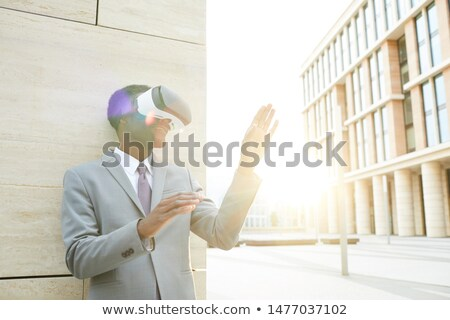 Businessman gesturing while wearing virtual reality simulator Stock photo © wavebreak_media