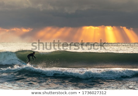 surfer with surfboard at sunrise Stock photo © ssuaphoto
