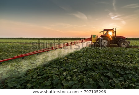 tractor spraying field stock photo © monkey_business