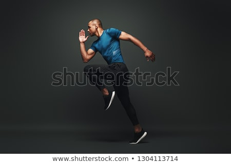 Concentrated strong sportsman running isolated Stock photo © deandrobot