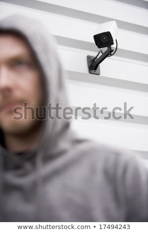 Surveillance Camera And Young Man In Hooded Sweatshirt Stock photo © monkey_business