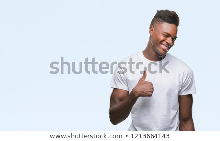 Smiling african man showing ok sign and looking at camera Stock photo © deandrobot