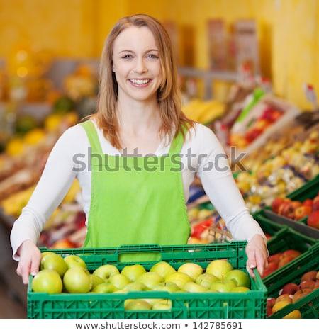 Supermarket worker with box full of apples. Stock photo © RAStudio