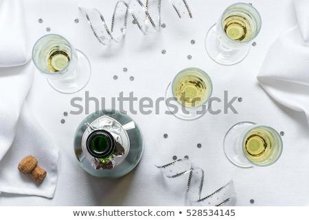 шампанского бутылку четыре флейты таблице Открытый Сток-фото © dashapetrenko