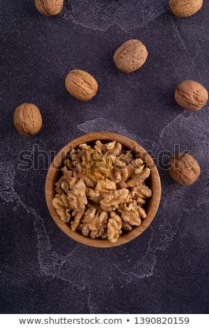 Kom geheel groep vers zaad noten Stockfoto © Digifoodstock