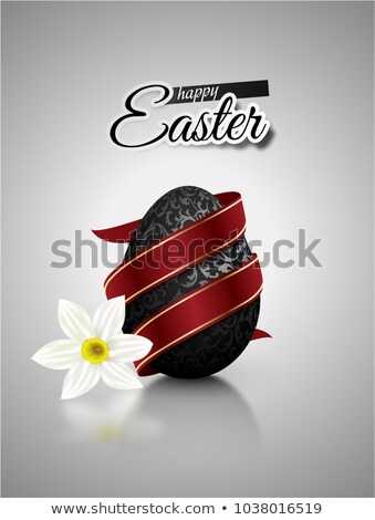 Black mat realistic egg with metallic floral pattern diagonal wrapped red ribbon. Gray background Stock photo © Iaroslava