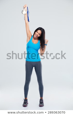 Mutlu kadın atlet madalya beyaz Stok fotoğraf © wavebreak_media