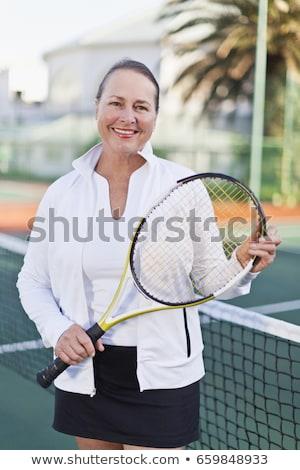 Idősebb nő teniszütő bíróság fitnessz portré Stock fotó © IS2
