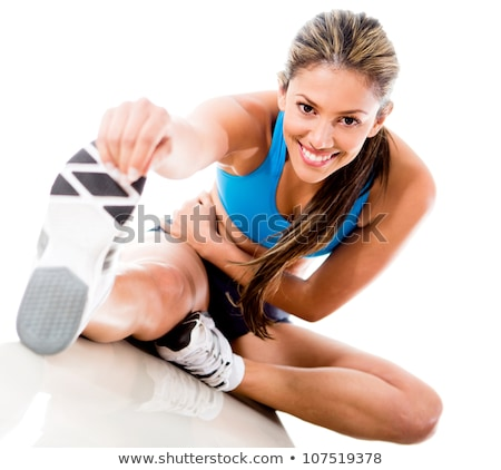 smiling fitness woman warming up in studio stock photo © deandrobot