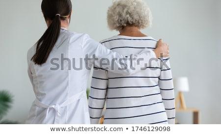 fysiotherapie · pijn · pijn · rehabilitatie · fysiotherapie · behandeling - stockfoto © lightsource