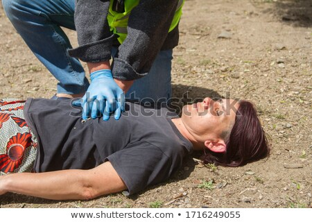 Paramedics practicing cardiopulmonary resuscitation on mannequin Stock photo © wavebreak_media