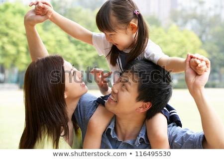 Apa lánygyermek háton lány férfi női Stock fotó © IS2