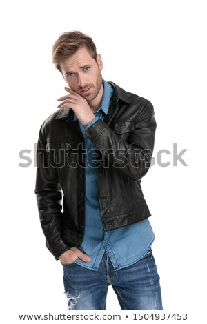 portrait of seductive young man with hands in pockets Stock photo © feedough