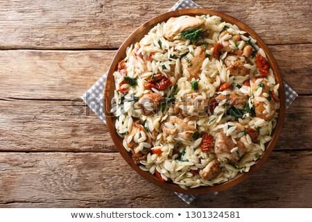 pasta, vegetable salad and roast chicken on table Stock photo © dolgachov