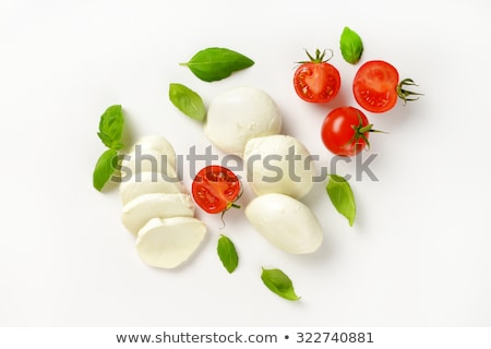 fresh mozzarella cheese with tomatoes and basil leaf on white background stock photo © denismart