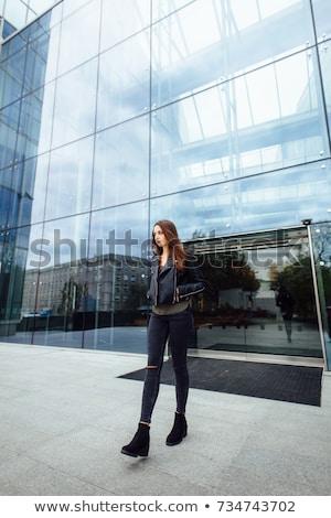 kobieta · długie · włosy · czarny · dżinsy · stwarzające - zdjęcia stock © alones