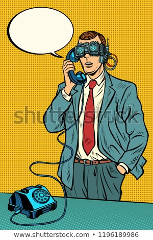 vr glasses steampunk cyberpunk man talking on a retro phone stock photo © studiostoks