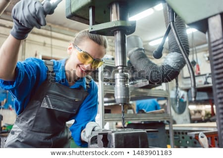 Woman worker in metal workshop using pedestal drill Stock photo © Kzenon